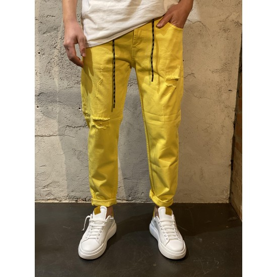 Pantaloni slim fit gialli con rotture