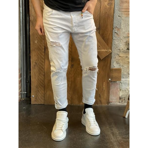 Pantaloni bianchi  slim con rotture