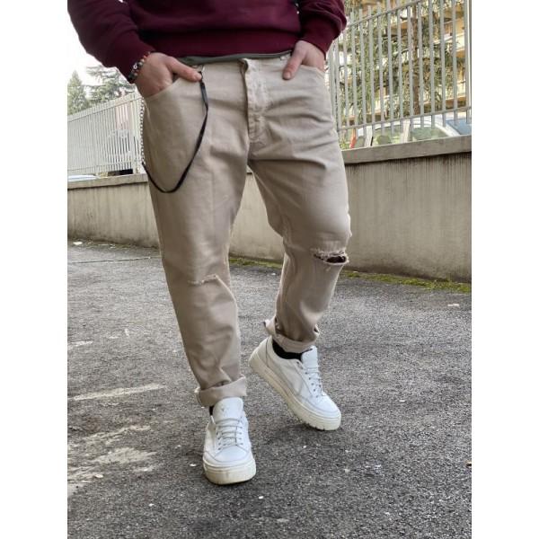 Pantaloni strappati sul ginocchio beige