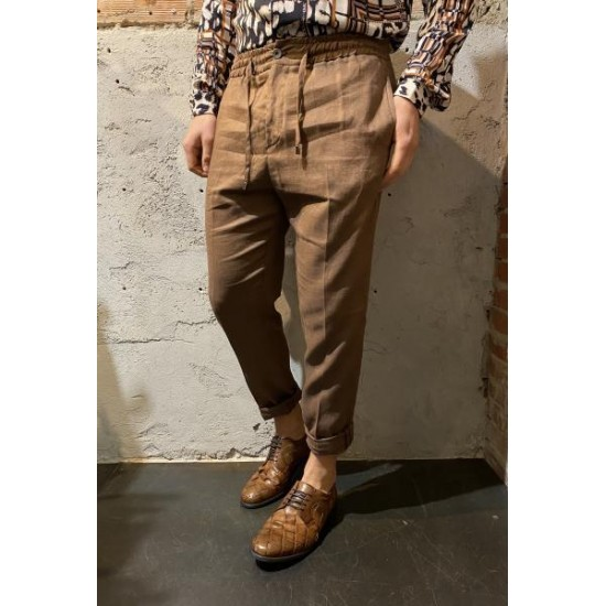 Pantalone in lino tabacco out